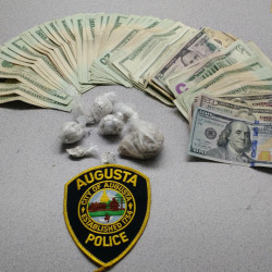 Augusta police released this photo of money and heroin that authorities say they found after searching a Ridge Road home on Monday.