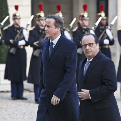 Britain's Prime Minister David Cameron, left, and France's President Francois Hollande arrive at the Elysee Palace in Paris, Monday.