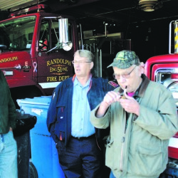"Lewis ""Duddy"" Brown, left, Ron Cunningham and Andy Cooper chat in the bay of the Randolph Fire station in this 2007 file photo. Brown died Monday night after being hit by a car outside his home."