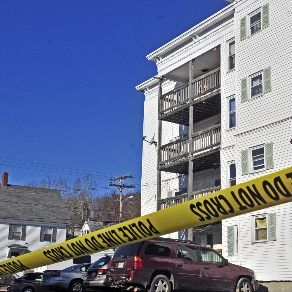 Police tape surrounds the parking lot at 75 Washington St. on Tuesday in Augusta, where police say 31-year-old Joseph Marceau was killed Monday night.