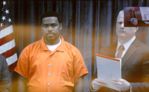 Damik Davis, 25, of New York, who has been charged with murder following a Monday night slaying in Augusta, appears in court Wednesday via video link at the Capital Judicial Center.