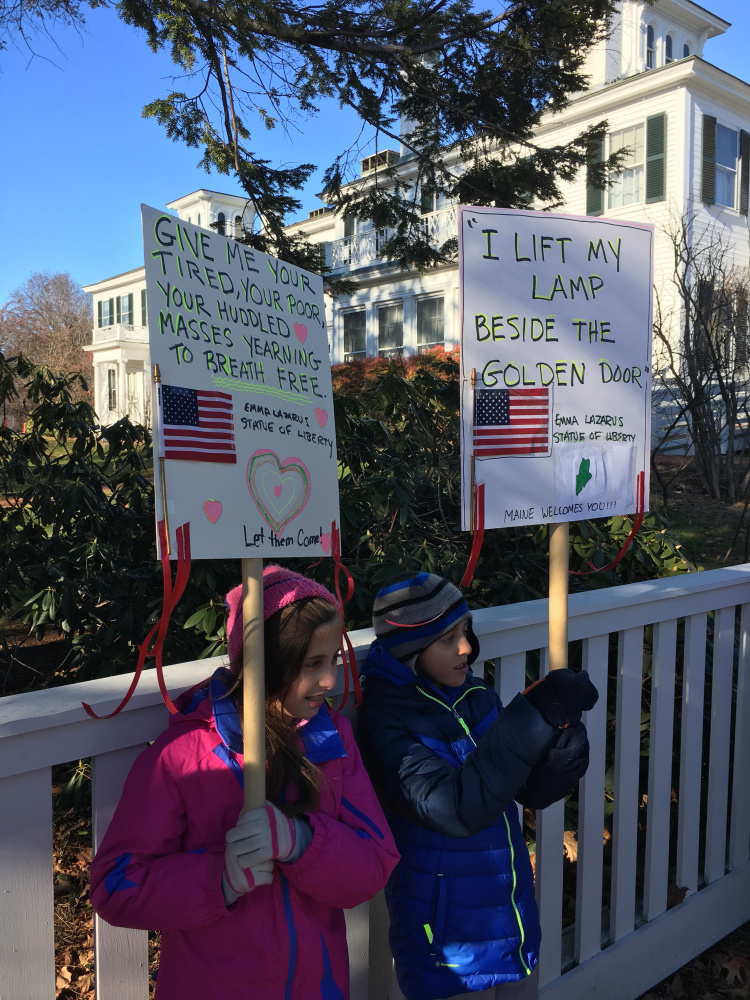 Ava and Noah Katz, 10-year-old twins from Hallowell, participated in Wednesday's vigil in support of Syrian refugees held outside the Blaine House in Augusta.