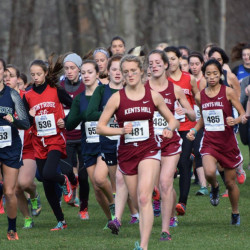 Anne McKee, of Kents Hill, leads a pack of runners during the New England Prep School Division 4 championship race in South Kent, Connecticut recently. McKee won the race for her third consecutive prep school title.