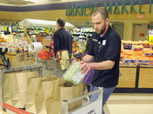 Hannaford employee Joe Stanhope fulfills an order Monday for the new Hannaford To Go at the Whitten Road in Augusta. For a $5 service fee if the order is less than $125, customers can order items and pick them up outside the store. If the order is more than $125, the service is free.