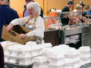 Shirley Everhart laughs with other volunteers as they prepare boxes of pie for meals that will be delivered from the community Thanksgiving dinner put on by the Augusta Valley Scottish Rite Masons at Gardiner Area High School on Thursday.
