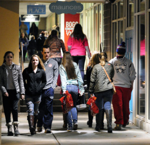 Shoppers walk between stores in the Marketplace at Augusta at 12:43 a.m. on Friday.