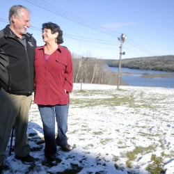 Marlee Johnston's parents, Ted Johnston and Marlene Thibodeau, stand at the ski slope at Kents Hill School in Readfield last week. Marlee had planned to enroll in the school before she was killed 10 years ago. The couple raises funds for the private high school and sponsors a ski competition in her memory.