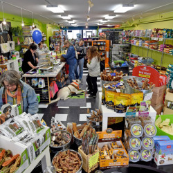 Shoppers browse among the merchandise Saturday at Loyal Biscuit on Main Street in Waterville.