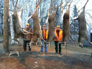 Hunters at 15 Mile Stream Lodge in The Forks the week before last bagged six deer weighing more than 200 pounds in three days. Shown with some of them are, from left, Paul McDonald of Tewksbury, Mass.; Shane Crommett, owner of 15 Mile Stream Lodge; and Robert Ward of Andover, Mass. Local business owners who cater to deer hunters say this year's good season has helped boost the economy of northern Somerset County.