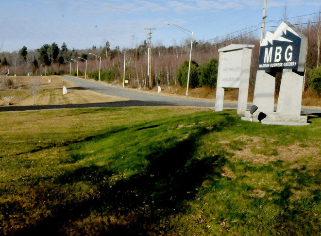 The entrance to the Madison Business Gateway park shows where a proposed 4-megawatt solar farm could be built in the wooded area on the right.
