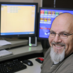 City of Augusta dispatcher Mike Rankins at his console Monday at the police department. Rankins is retiring as a full-time dispatcher after 20 years with Augusta.