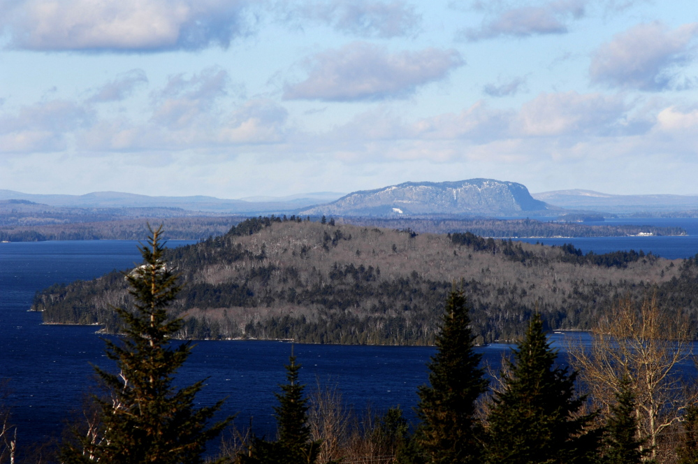 Mount Kineo rises behind Moosehead Lake. Plum Creek, which owns hundreds of thousands of acres in the Moosehead Lake region, is being sold to Weyerhaeuser Co. to form what is expected to be one of the world's largest timberland companies.