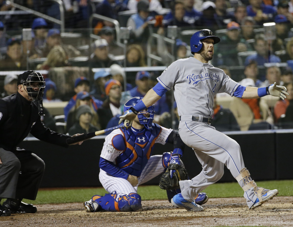 Alex Gordon of the Royals hits an RBI single in the fifth inning Saturday night during Game 4 of the World Series against the New York Mets. Kansas City capitalized on an error in the eighth inning to erase a 3-2 deficit, and now can clinch its first World Series title since 1985 with a victory Sunday night.