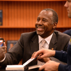 "Presidential candidate Ben Carson shakes hands with local residents during a book-signing event in Lake Sumter Landing, The Villages, Fla., on Monday. His campaign has clarified a statement in the book that he was offered ""a full scholarship to West Point."""