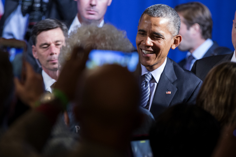President Barack Obama shakes hands after speaking during a Organizing for Action event, on Monday, in Washington.
