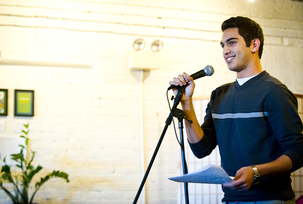 Ibrahim Shkara reads a story to a crowd of over 80 community members, including mentors, at the Telling Room in Portland in June. Photo by Molly Haley
