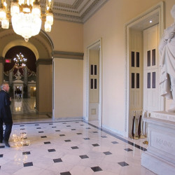 Sen. Angus King walks past the statue of long-ago Maine Gov. William King, which has stood in the U.S. Capitol since 1878, but may not stand there forever, depending on results of a survey.