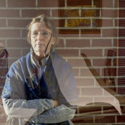 At the Milestone Foundation, primarily a short-term detox center, Dr. Mary Dowd tries to line up long-term treatment for addicts, but there are far more patients than available services. This double exposure shows her at the foundation, and in a patient exam room.