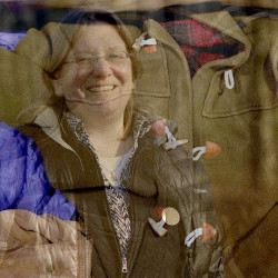 One of Jessica Maurer's projects for the Maine Association of Area Agencies on Aging is keeping seniors warm in winter by providing them with coats, like the one at L.L. Bean superimposed above.