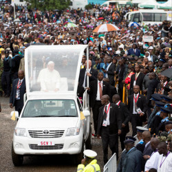 Pope Francis waves as he arrives to celebrate a Mass at the campus of the University of Nairobi, Kenya, on Thursday.