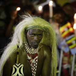 A man wears his traditional tribal clothing as he waits for the arrival of Pope Francis during his visit to Munyonyo, Uganda, Friday, Nov. 27, 2015. Pope Francis is in Africa for a six-day visit that is taking him to Kenya, Uganda and the Central African Republic. (AP Photo/Andrew Medichini)
