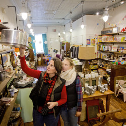 Debbie Wentworth and her daughter Sarah of Falmouth pull down an antique cake tin as they shop at Circa Home & Vintage on Congress Street on Saturday.