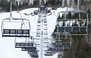 """Workers repair the King Pine chairlift at Sugarloaf in Carrabassett Valley in March, after an accident injured seven skiers. """"We're making these lifts as safe as possible with the most modern standards and components,"""" said Rich """"Crusher"""" Wilkinson, vice president of mountain operations."""