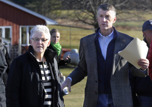 Gina McCarthy, the top administrator of the U.S. Environmental Protection Agency, visits Smiling Hill Farm in Westbrook to talk with farmers, including Warren Knight, right, who owns the farm with his family, on Monday. Farmers are concerned about new water quality rules.