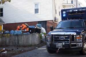 Investigators search for evidence behind 50 Elm St. on Friday. The discovery of a suspected meth lab at the address marks the 25th found by the MDEA in Maine so far this year. Photo by Chris Chase / Coastal Journal
