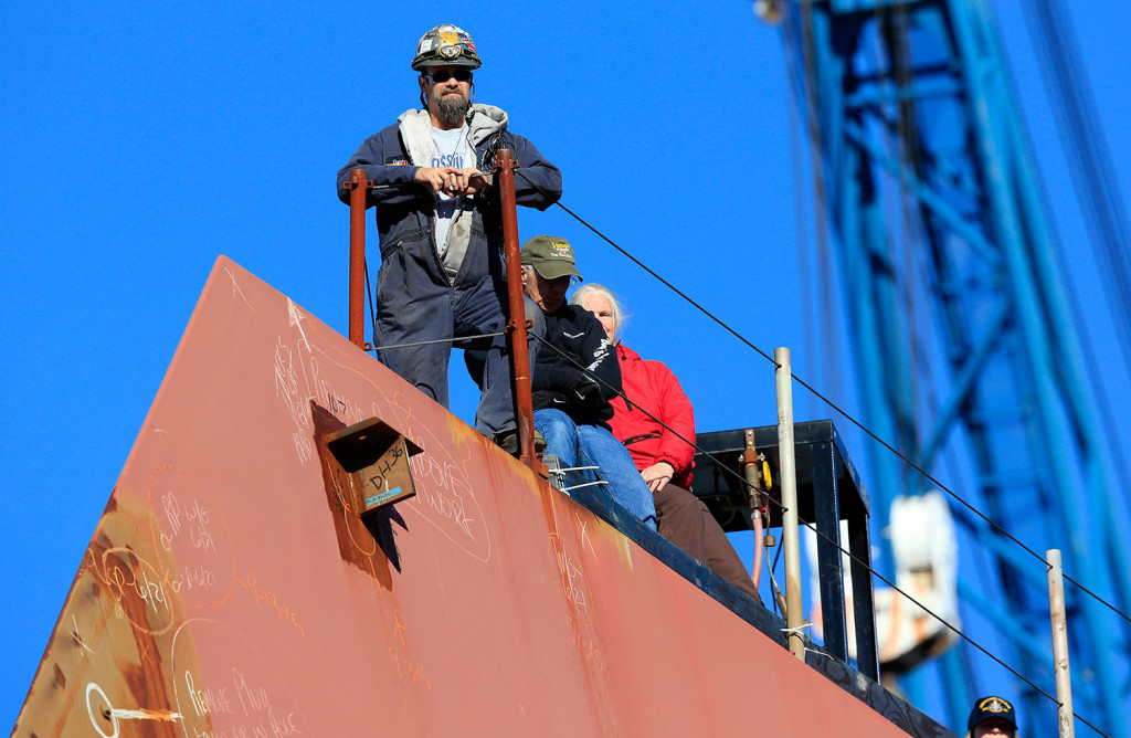 Workers watch a christening ceremony in October at Bath Iron Works from the bow of  the future USS Michael Monsoor. With labor relations already rocky, Bath Iron Works and the union representing shipbuilders have decided to get an early start on contract negotiations.