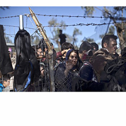FILE - In this Nov. 4, 2015, file photo, people wait in line to enter the migrant and refugee registration camp in Moria, on the island of Lesbos, Greece. Some Republicans are pushing back against aggressive opposition in their party to Syrian refugees resettling in the U.S., fresh evidence of a rift within the GOP that threatens to complicate the party's outreach to minorities heading into the 2016 presidential contest.  (AP Photo/Marko Drobnjakovic, File)
