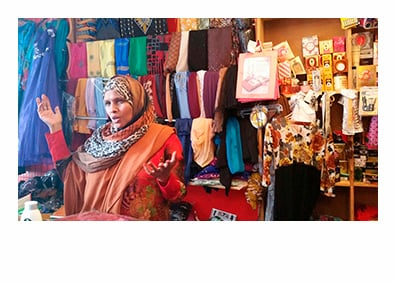Safia Hersi owns the Almadina Variety Store on Lisbon Street in Lewiston. (Photo by Susan Sharon, MPBN)