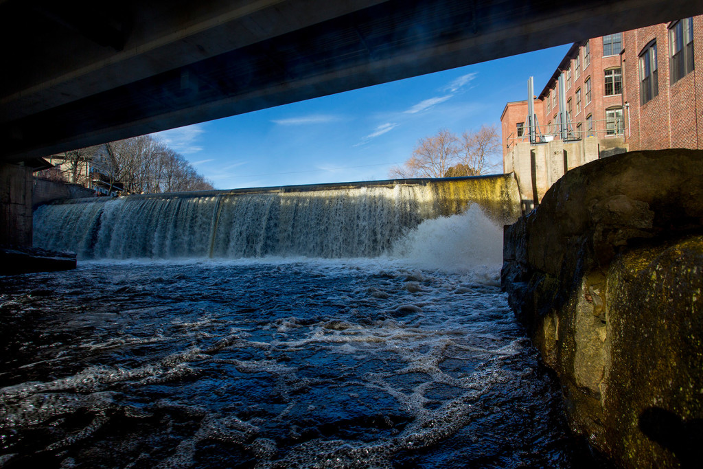 Water flows over the Kesslen Dam in downtown Kennebunk on Monday. Removing the Kesslen Dam and two others would allow the lower 9 miles of the Mousam River to flow freely. Gabe Souza/Staff Photographer