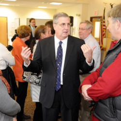 James Conneely, who will become the new president at the University of Maine at Augusta, speaks with people attending an announcement ceremony Tuesday at the UMA campus.
