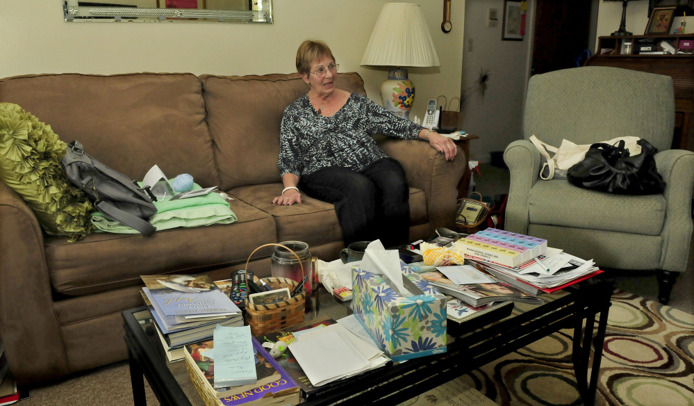 Spring House Gardens resident Marjorie Whipple relaxes in her apartment on Tuesday.  The 25 apartment complex is facing foreclosure.