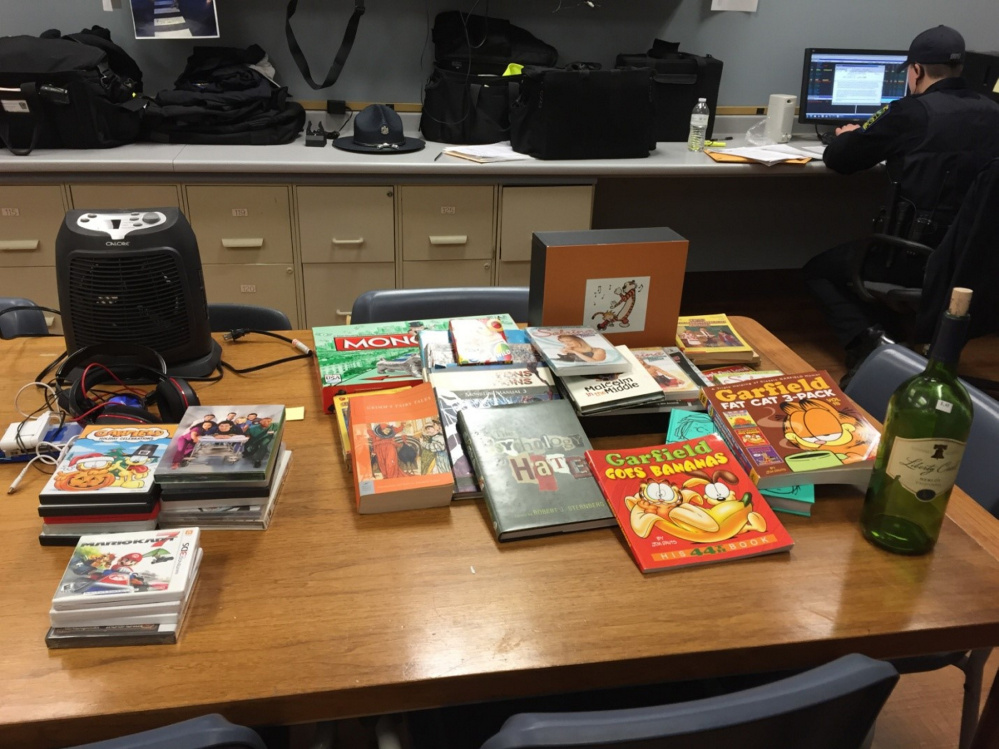 Three people, including an 11-year-old boy, were charged with burglary in Skowhegan and police recovered items including cartoon books, DVDs and video games.