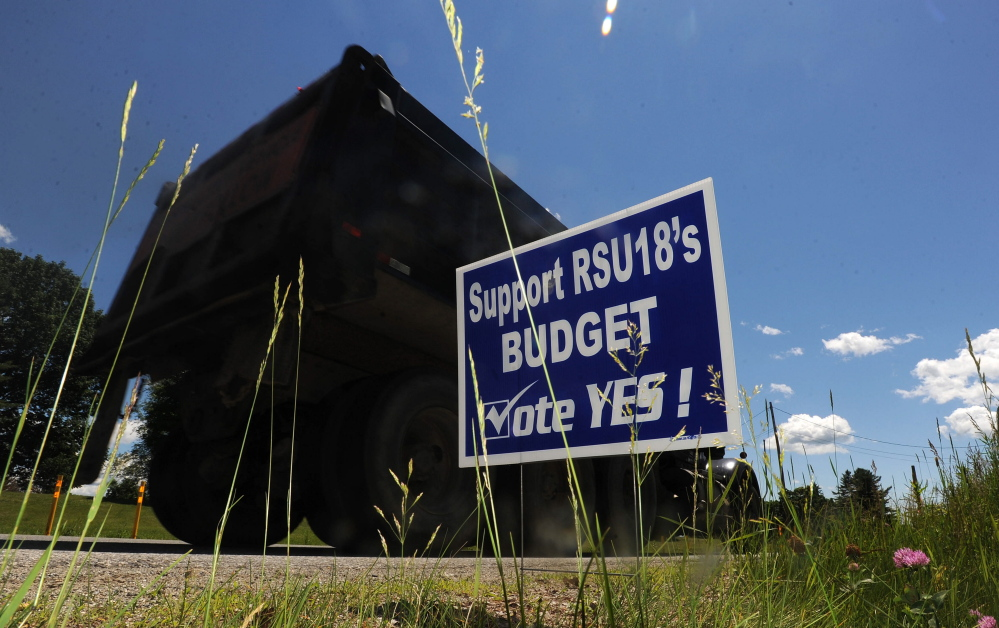 A Regional School Unit 18 campaign budget sign is seen on Oakland Road in North Belgrade last June. School officials intend to keep residents in the district informed early about this year's budget process in hopes of keeping it from becoming as fractious as it has in recent years.