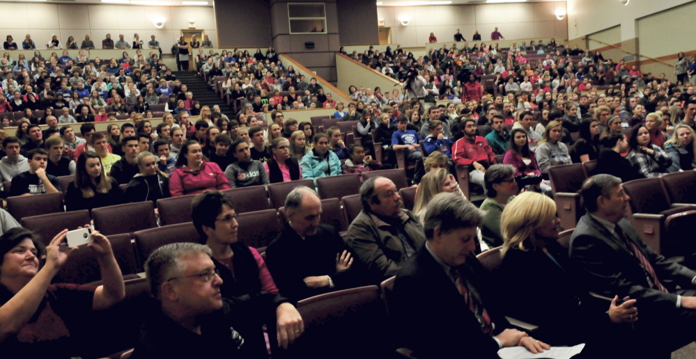 Messalonskee High School students and staff and state officials listen as Paula Callan received the Assistant Principal of the Year award on Thursday.
