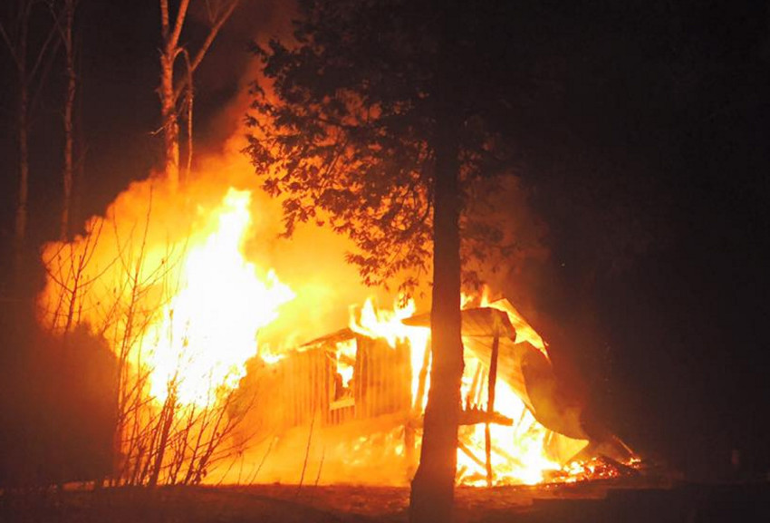 West Forks firefighters respond to a fire at a structure off Route 201 in The Forks early Friday morning.