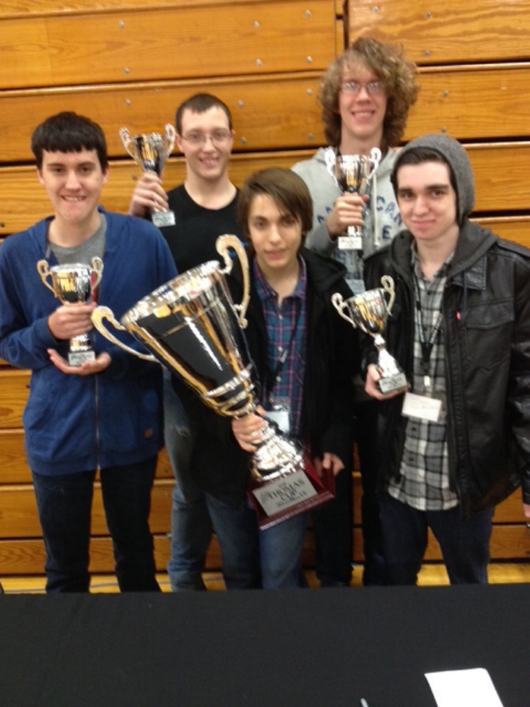 The Winslow High School team, The Big Boyzzzz, won the Thomas Cup, a technology competition that took place all night Friday into Saturday morning at Thomas College in Waterville. The team consists of, in the back row from left, Benjamin Lemieux, Josh Morissette and Jordan Maxell; and in the front row from left, Sylas Rayborn and Jacob Crosby