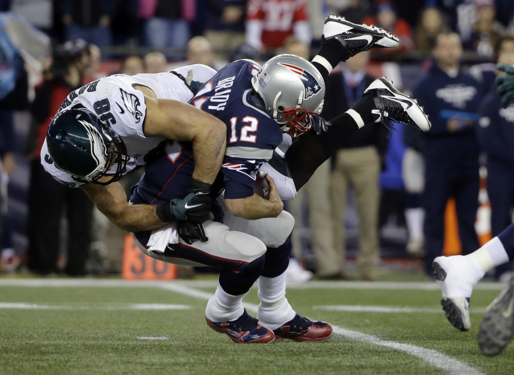 Philadelphia Eagles linebacker Connor Barwin (98) sacks New England Patriots quarterback Tom Brady (12) during the first half Sunday in Foxborough, Mass. The Eagles beat the Patriots, 35-28.