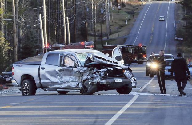 SIDNEY, ME-  DECEMBER 6: Police and firefighters investigate the scene of a fatal two- vehicle accident on Route 27 in Sidney on Sunday afternoon. This pickup truck and a vehicle that rolled over in a nearby ditch  were involved.  (Photo by David Leaming/Staff Photographer)
