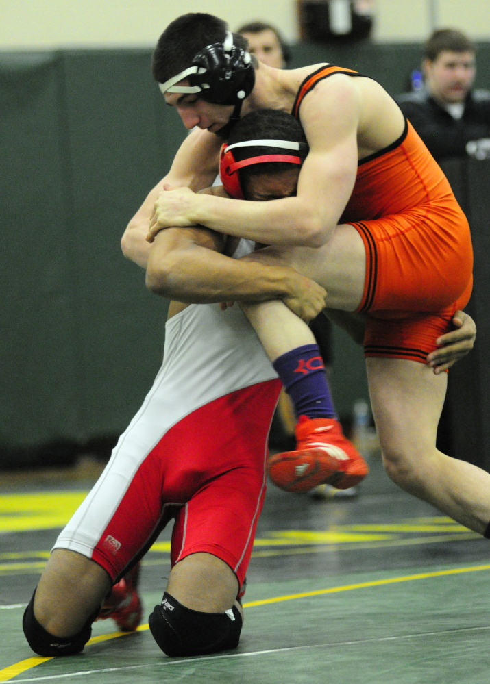 Cony's Zeko Caudill, left, and Skowhegan's Julian Sirois compete in the 138-pound finals at the Eastern A championships last season. Sirois won his 150th career match at the Westbrook Invitational. He is wrestling at 160 pounds this season.