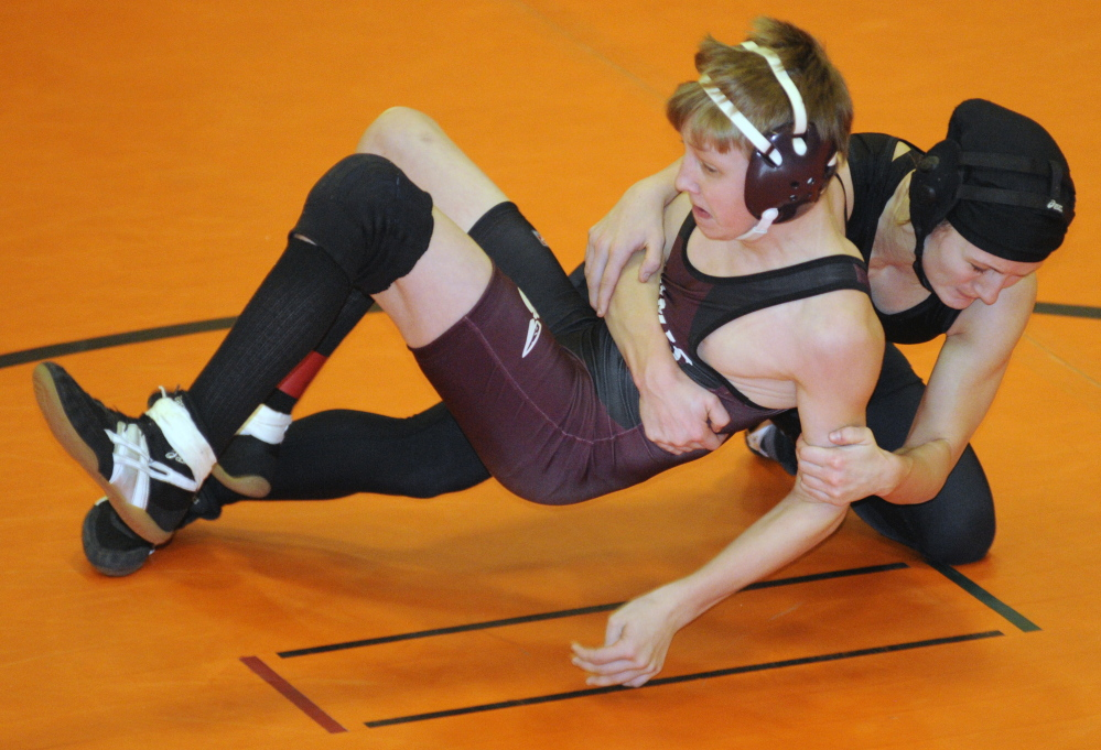 Nokomis' Josh Brown, left,  and Monmouth's Emily Levasseur compete in the 113-pound championship match at the Tiger Invitational last season. Brown won the title and will be back to try and defend it on Saturday.