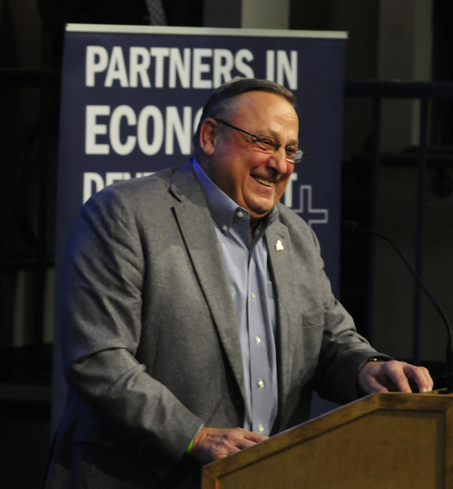 Gov. Paul LePage recognizes people in the audience during an announcement Wednesday that Collaborative Consulting company will open a business in the Hathaway Creative Center in Waterville.