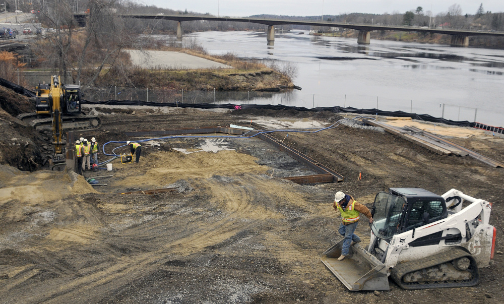 Workers with Sargent Corporation excavate a hole Tuesday for a 400,000 gallon sewer storage tank at the confluence of Cobbossee Stream and the Kennebec River in Gardiner, part of the city's upgrade to the sewer infrastructure in the community.