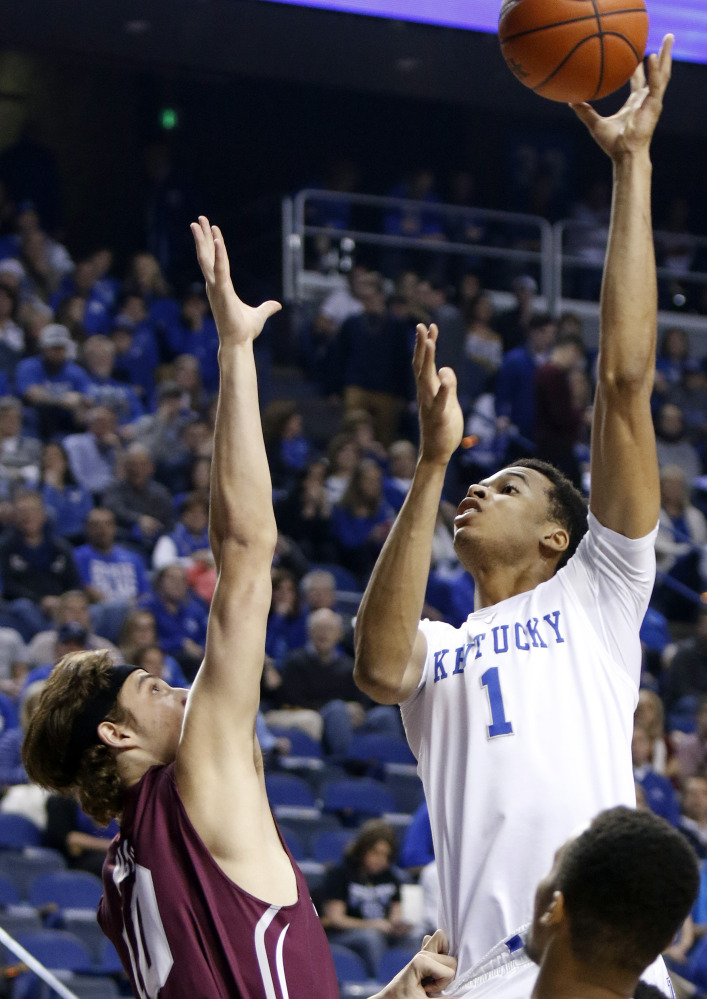 Kentucky's Skal Labissiere (1) shoots over Eastern Kentucky forward and former Messalonskee standout Nick Mayo during the first half of a game Wednesday in Lexington, Kentucky. Mayo finished with nine points.