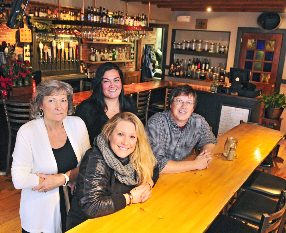 Coby Thibeau, back row left, and daughter Deanna Thibeau along with Leah Sampson and Geoff Houghton pose for a photo on Thursday at the Maine House in Hallowell, where the Thibeau family is working to sell the business to Sampson and Houghton.