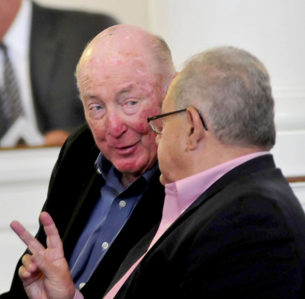 In this Aug. 17, 2014 photo, U.S. Hockey Hall of Fame coach Jack Kelley, left, speaks with an attendee of a memorial service for former baseball coach John Winkin Jr. held at Colby College. It was announced Thursday that Kelley will be one of 11 inductees in the class of 2016 for the Maine Sports Hall of Fame.