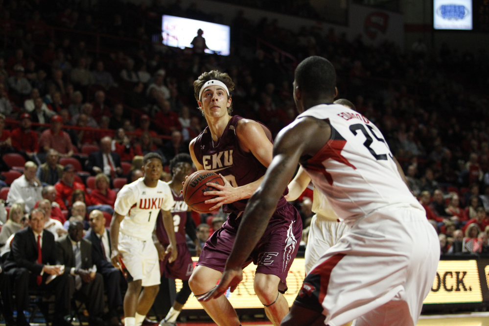 Eastern Kentucky forward Nick Mayo, left, looks for a shot during a Dec. 1 game against Western Kentucky.
